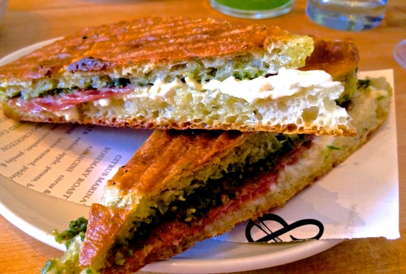 Arugula pesto, ricotta and soprassetta panini at Cakes & Ale Bakery cafe.