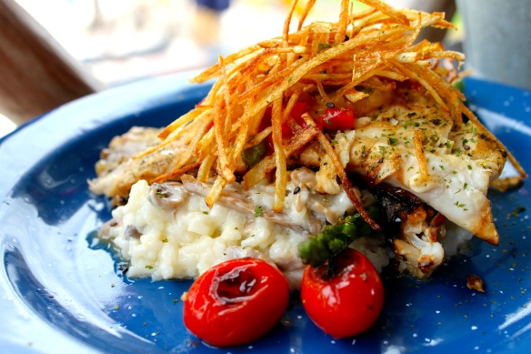 "Sea bass ""Merkadito style"", on a bed of creamy risotto, grilled veg."